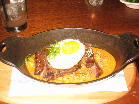 Skirt steak with kimchi fried rice and duck egg