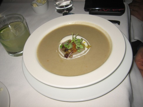 Sunchoke soup with smoked ricotta, sweet potato beignet and truffled grape vinaigrette